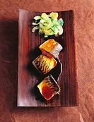 Steamed mackerel with cucumber and tamari on wooden plate