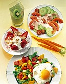 Fried eggs with stir-fry vegetables, salad, cereal, carrots and kiwi juice in plate