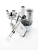 Three types of hand mixers on white background
