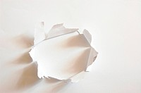 hole with copyspace in blank sheet of paper