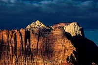 The setting sun shines on the West Temple at Zion National Park as seen from Gooseberry Mesa, Utah.