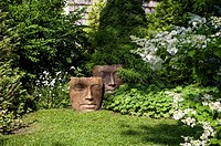 A garden with face statuary in île d´Orléans, Quebec, Canada.