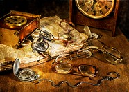 many Glasses and watch lying on a wooden table
