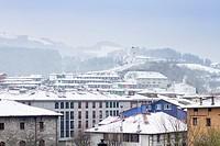 Snow in Azkoitia and San Martin clock on the top of the hill, Gipuzkoa, Basque Country