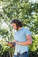 Young man using tablet in the park