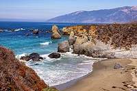 Looking down on a beach and rocky coastline. Big Sur, California, United States.