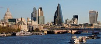 Various iconic buildings including st. Pauls Cathedral, Heron Tower, Cheesegrater and Walkie Talkie Tower, form skyline above River Thames and Blackfr...