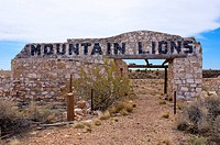 An abandoned mountain lion attraction at a former campground in the Route 66 ghost town of Two Guns, north of Meteor Crater, Arizona. Two Guns is an a...