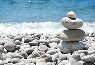 Stack sea pebbles against the blue sea