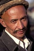 Head and shoulders portrait of Tajik man