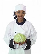Studio isolated woman female chef with green cabbage on white