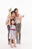 Young family playing paper airplane with smile