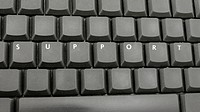 Top view of word support spelled on computer keyboard.