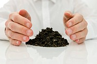 Male hands around pile of soil. Concept of alternative medicine.