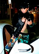 Bai Ling out and about in Beverly Hills exposing lots of cleavage wearing a unbuttoned jacket and knee high red boots Featuring: Bai Ling Where: Los A...