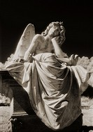 An angel waits / Black and white infrared shot of statue of angel in a cemetary.