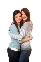 Two girlfriends in a tender embrace