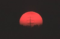 230 KV power pole in front of sunset, Germany
