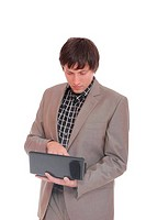young business man standing with laptop