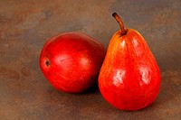 Two fresh ripe organic red bartlett pears