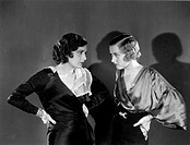 Hollywood, California: c. 1930.Two women staring angrily at each other.