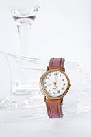 wristwatch and glass