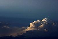 Sun peeking through clouds.