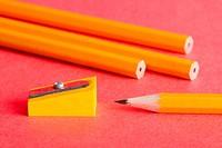 Pencils, pencil sharpener on red