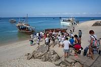 western tourists ready for a boat trip on Zanzibar.