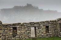 Archaeological site of Machu Picchu, Cusco, Peru. Intihuatana seen from the Acllawasi.