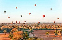 Multicolored air balloons over ancient Buddhist temples in Bagan, Myanmar.