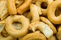 Taralli biscuit with ingredients on the wood table