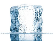 Single ice cube with water drops