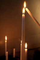 Pilgrim lighting a candle.
