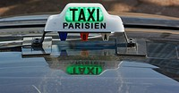 Sign on roof of a Paris taxi with reflection, France, Europe.