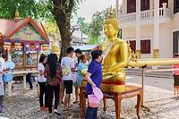 Laos, Vientiane, People celebrating New Year.