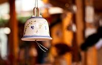 Christmas bell against defocused background