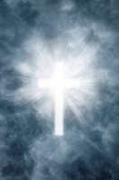 Religious cross shining through clouds