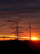 wind energy harvesting wind mills at sunrise
