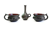 Two black decorative ceramic pots and small jug isolated