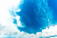 blue sky background with sun and white clouds