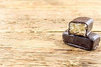 a chocolate background with pralines