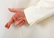 Fingers crossed behind back - white suit
