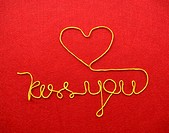 kiss you ribbon greeting and hearts on red background