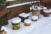ASSORTMENT OF SNOW-TOPPED TERRACOTTA POTS