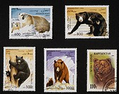 Top and bottom left and centre: postage stamp from the Bears series, 1996, depicting Polar bear with cub (Ursus maritimus), Sun bears (Helarctos malay...