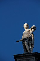 statue on top of the capitol hill building in Rome, Italy