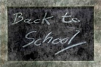 grunge chalkboard or blackboard with text Back to School