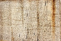 concrete wall with rust stains