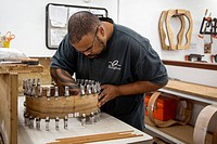 Guitar factory. Worker making guitars. Photographed at the Taylor Guitars factory, El Cajon, California, USA.